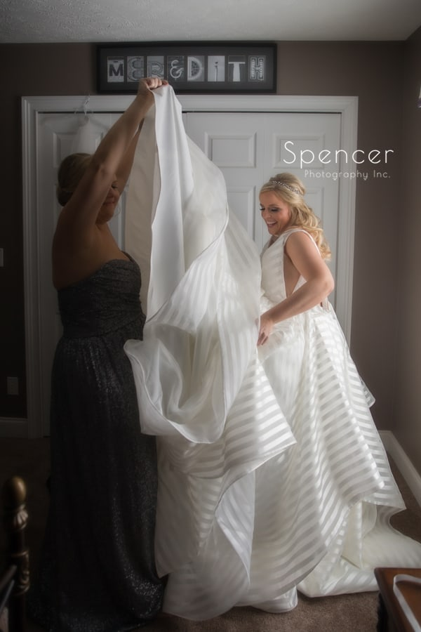 bride putting wedding dress on in chagrin falls home