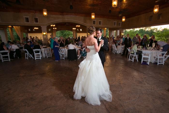 bride dancing with her dad under pavilion at Gervasi