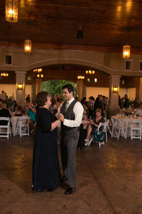 groom dancing with mom at pavilion at Gervasi