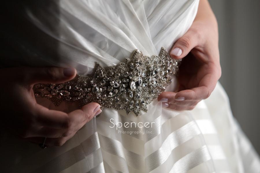 bride holding wedding dress detail