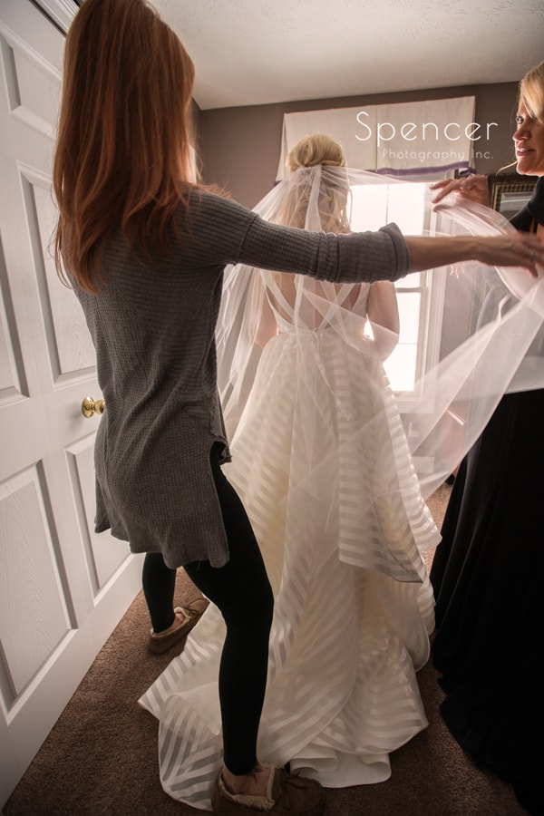 veil being put on bride