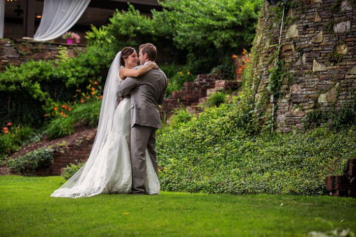 bride and groom in grassy courtyard of club at hillbrook