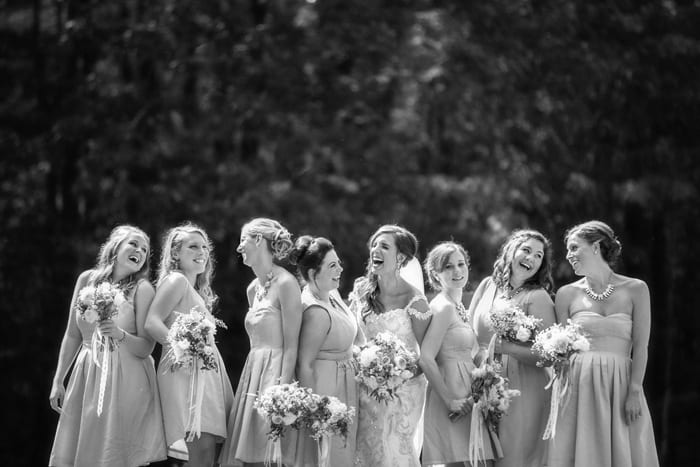 bridesmaids lauging in wade oval park