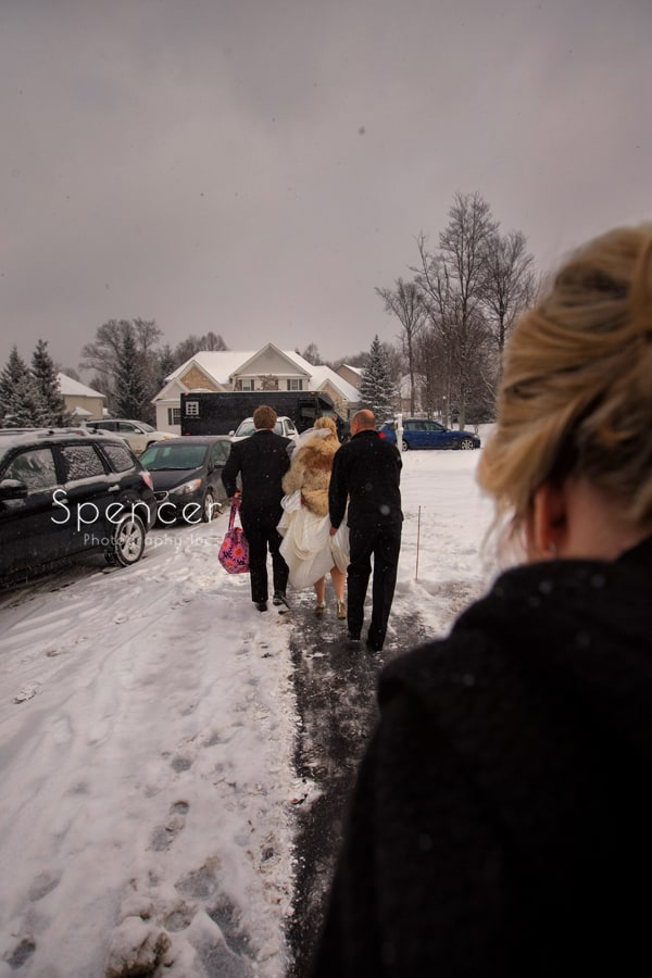 bride leaving for her winter wedding ceremony