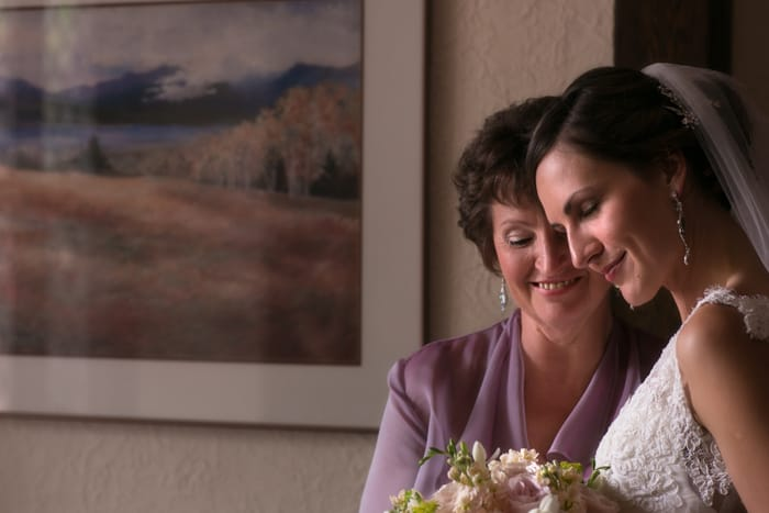 bride and mom hugging before her wedding ceremony at club at hillbrook
