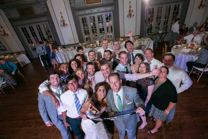 wedding guests pose for group picture at tudor arms