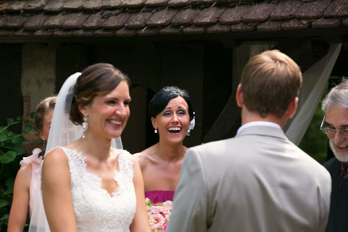 bride laughing at her wedding ceremony at hillbrook