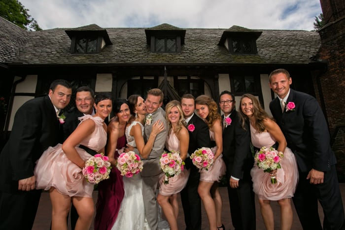 bridal party picture in front of house at club at hillbrook