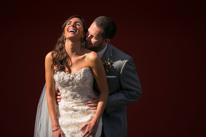 groom kissing bride while she laughs at cleveland museum of art