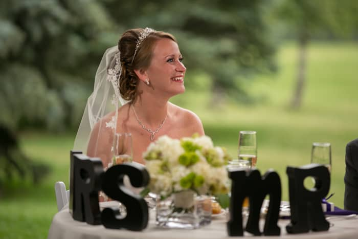 bride at head table at Gervasi Vineyard