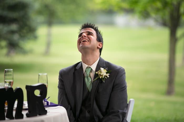 groom at head table at reception at Gervasi Vineyard
