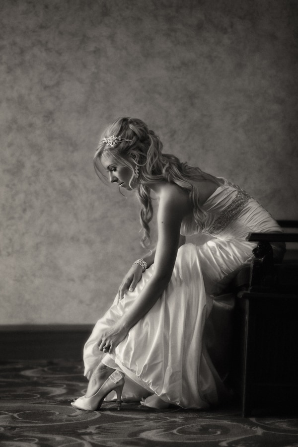 bride adjusting shoe at akron civic theater