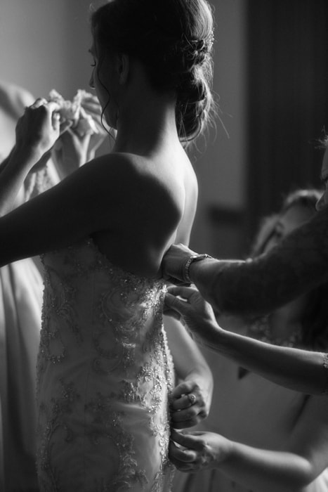 bride adjusting wedding dress