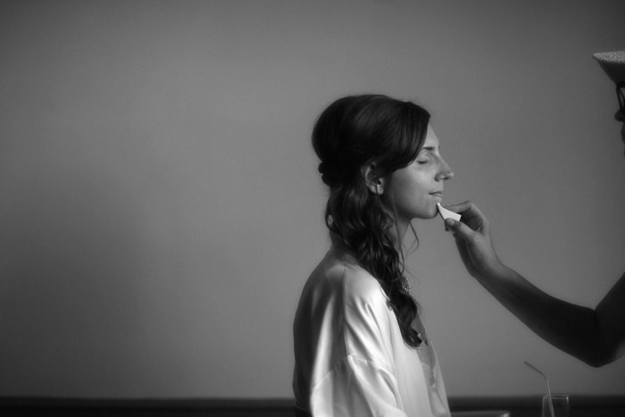 bride getting make up at tudor arms