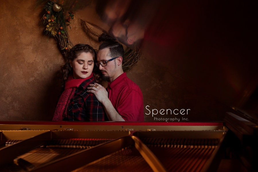 engagement picture of couple and a piano