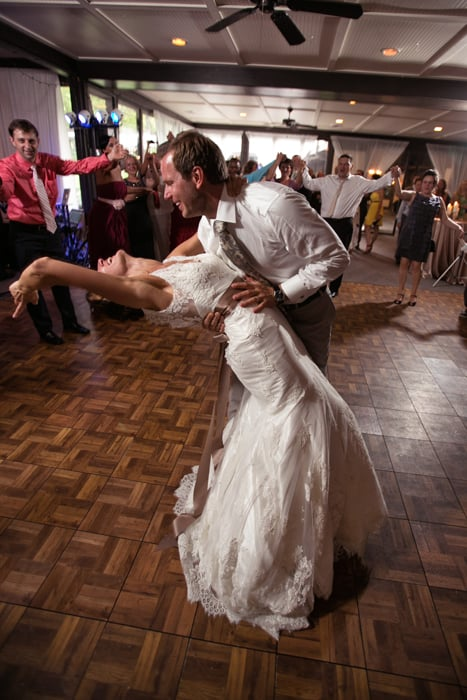 groom dips bride during their first dance