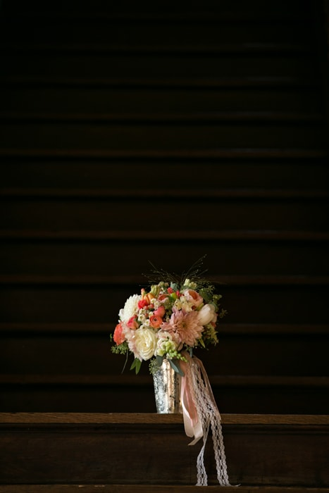 wedding bouquet on stairs of tudor arms cleveland