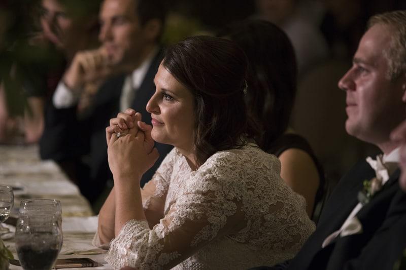 bride listening to maid of honor speech
