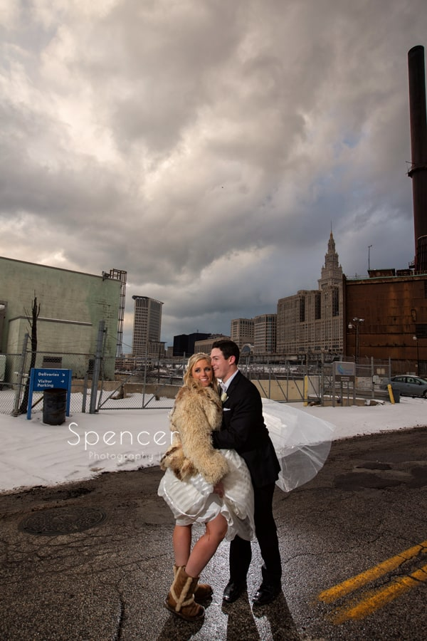 bride and groom hugging on canal street in cleveland
