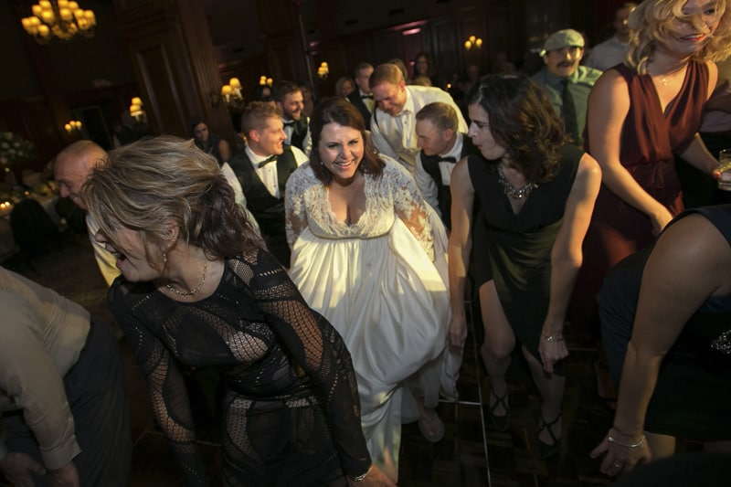 bride having fun at reception at union club of cleveland
