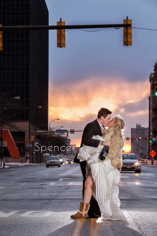 bride and groom kiss in front of cleveland renaissance hotel