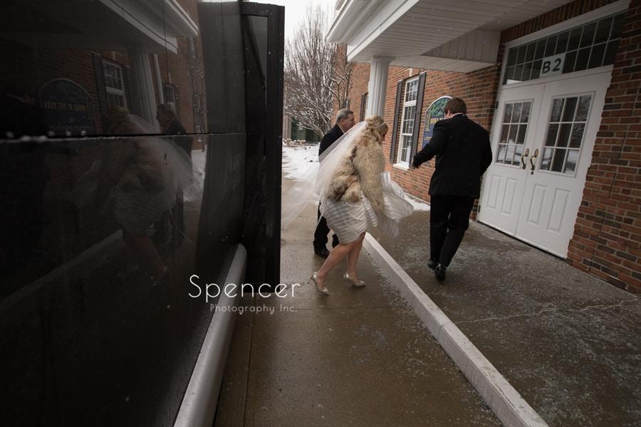 bride arriving to her winter wedding