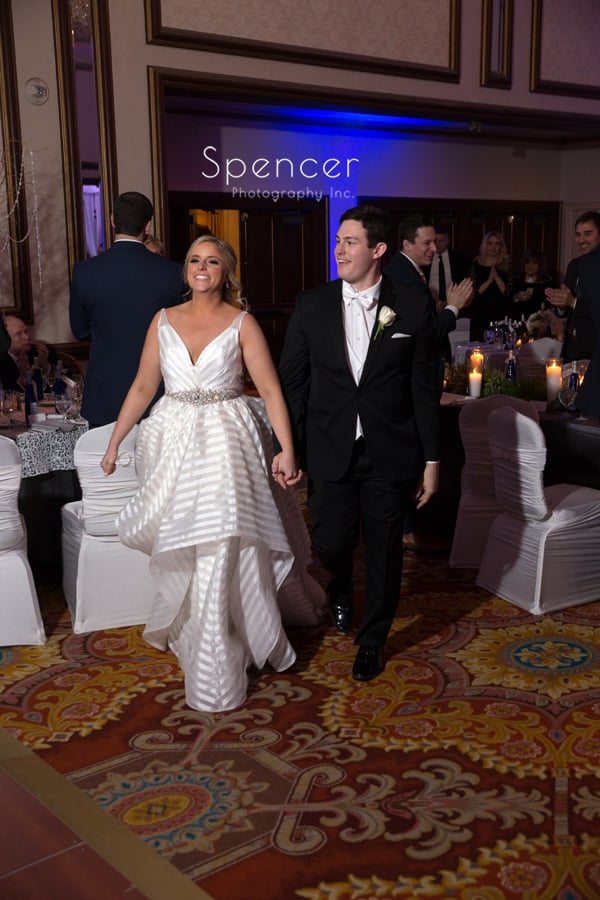 bride and groom enter their wedding reception at cleveland renaissance