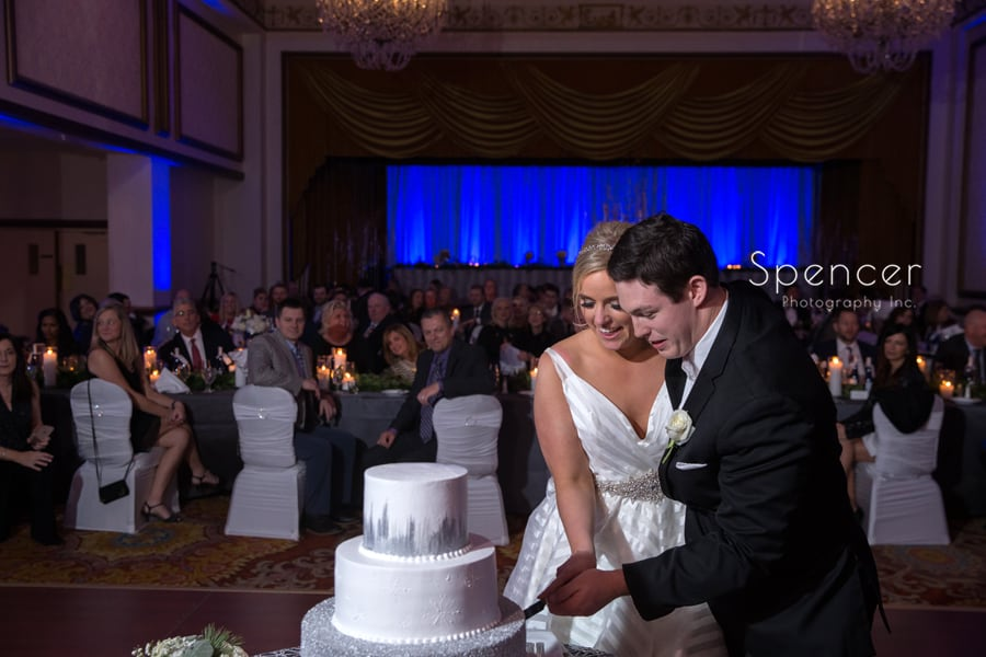 cutting the wedding cake in ballroom at cleveland renaissance