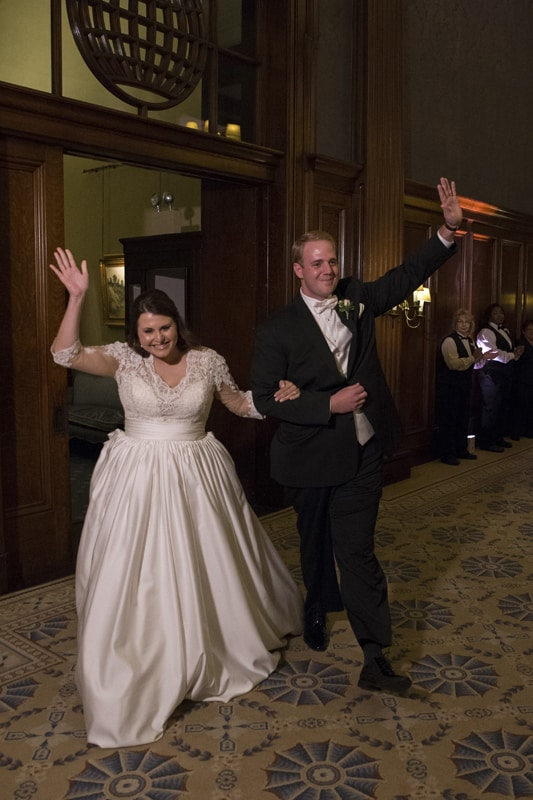 bride and groom enter their wedding reception at union club of cleveland
