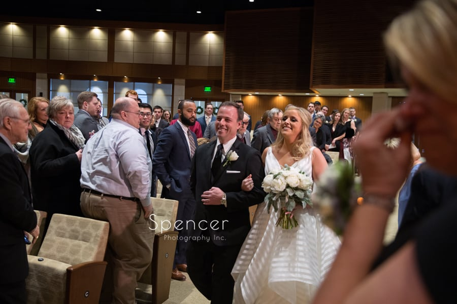 dad and bride walking down aisle of parkside church