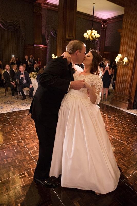 groom kissing bride on dancefloor of union club