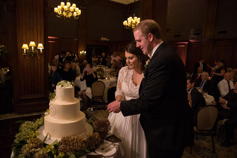 bride and groom cutting cake at receptionat union of cleveland
