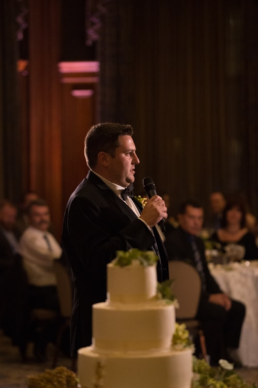 best man giving reception speech at union club reception