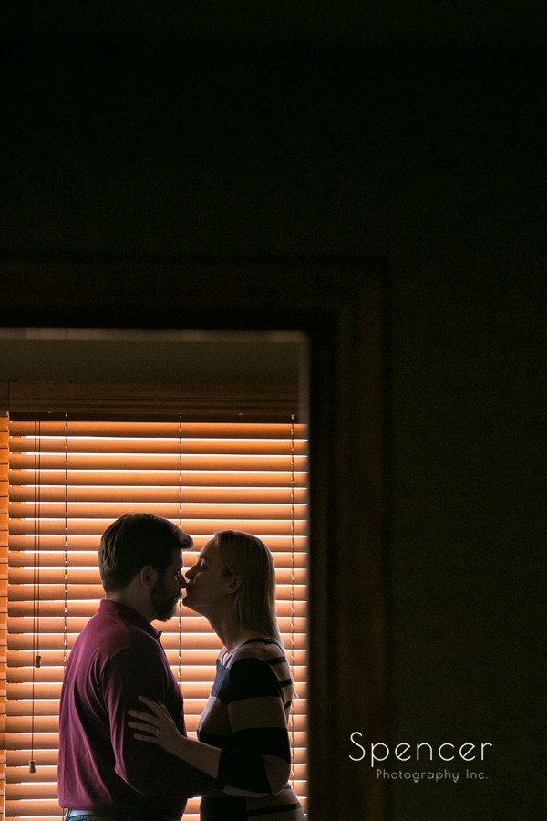 couple kissing in suite at firestone country club