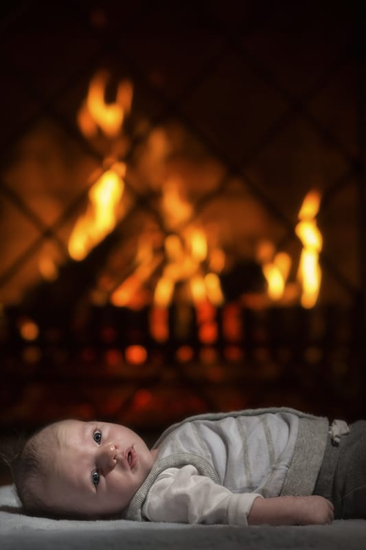 baby picture in front of fireplace