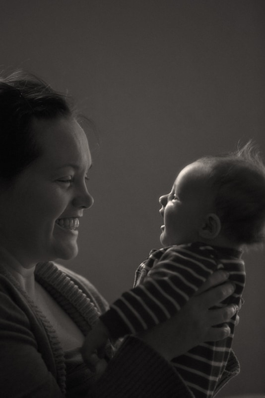 black and white picture of mom holding baby