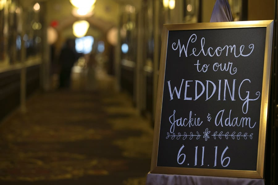 Sign inside wedding reception at Akron Tangier