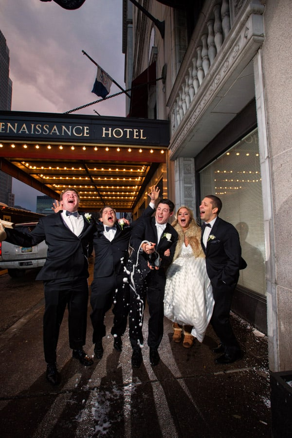 bridal party celebrate in front of cleveland renaissance