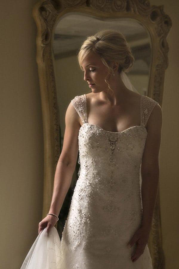 bride adjusting dress at silver lake country club