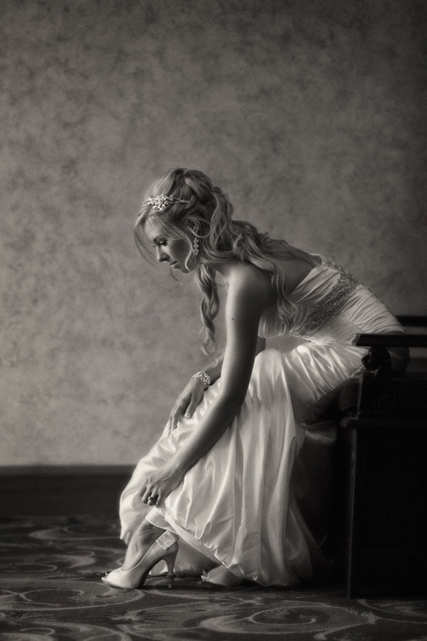 bride adjusting shoe at akron civic theater