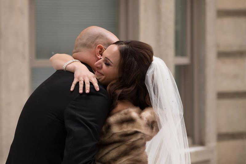 bride and groom hugging on wedding day at park lane