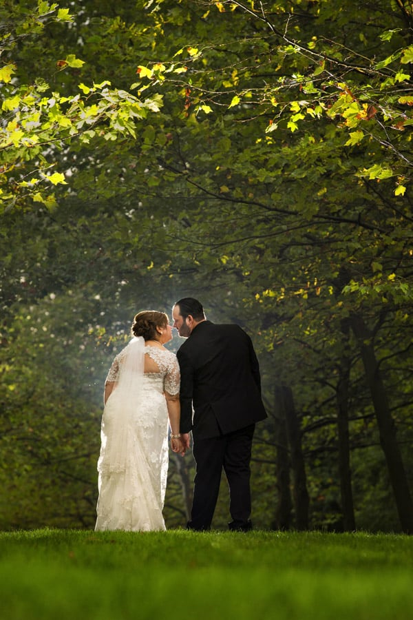bride and groom walking at stan hywet
