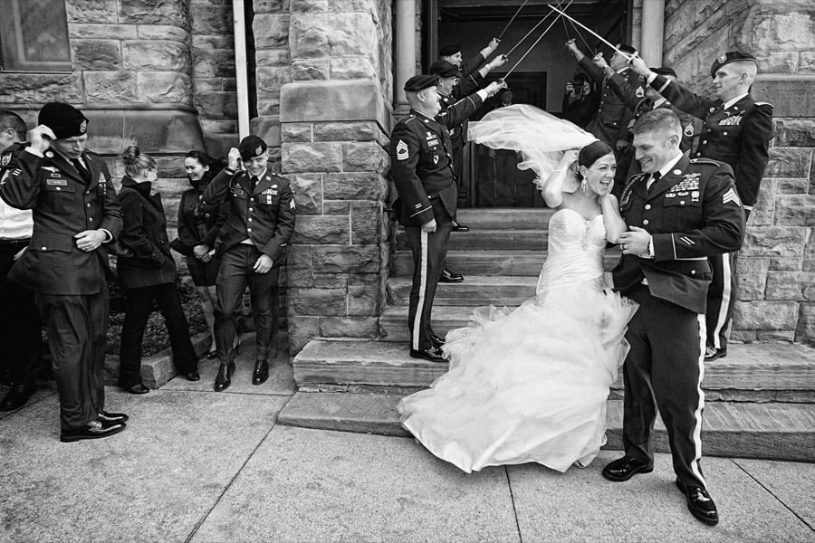 bride catches her veil as wind blows after her cleveland wedding