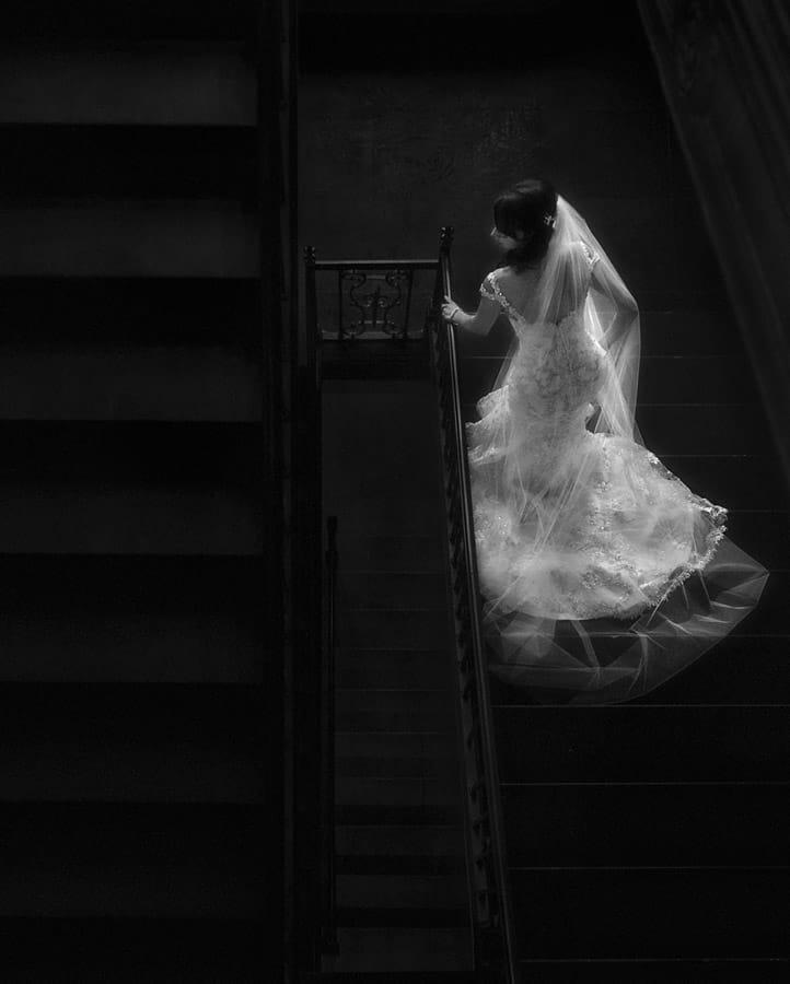 bride descending staircase at cleveland tudor arms hotel