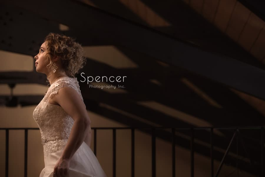 bride posing in the loft at shady hollow country club
