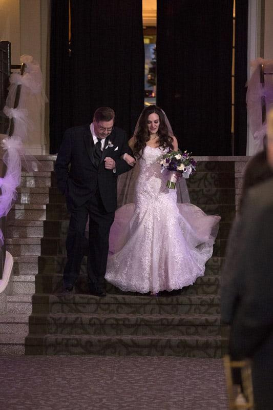 bride walking down stairs at wedding ceremony at ballroom at park lane