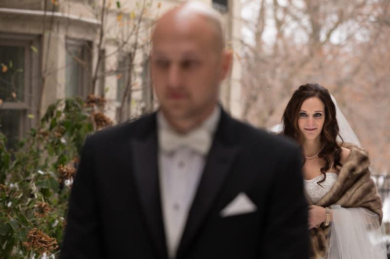 bride walking towards groom in courtyard of park lane ballroom