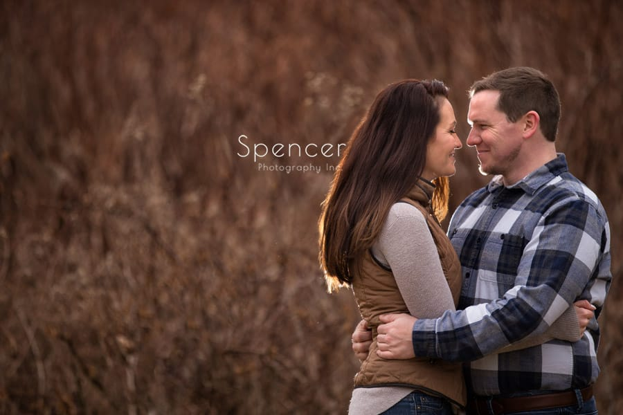 couple embracing during their engagment session in Peninsula
