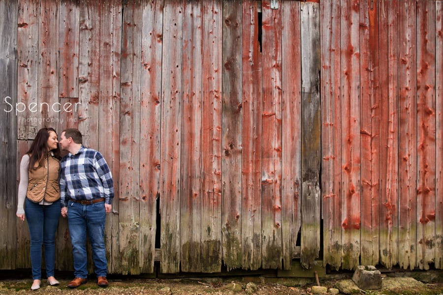 couple kissing against a barn in Peninsula Ohio