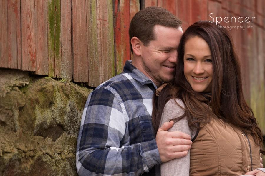 couple lauging at barn in Peninsula